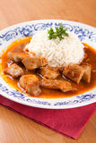 Fish goulash with rice and sauce Stock Photo