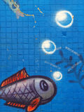 Fish graffiti. Childish graffiti at the tiles wall Royalty Free Stock Images