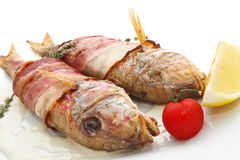 Fish grill. Tasty grilled fish with fruit Royalty Free Stock Images