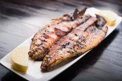 Fish on the grill Stock Photos