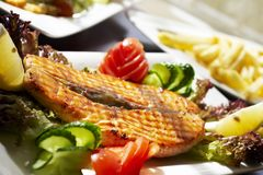 Fish-grill with vegetables. Stake from a salmon with vegetables and a potato Royalty Free Stock Photos