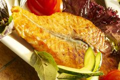 Fish-grill with vegetables. Stake from salmon with vegetables on white plate Stock Image