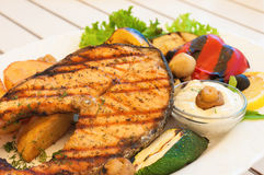 Fish grilled  with vegetables Royalty Free Stock Images