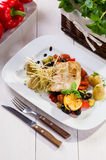 Fish with grilled vegetables Stock Photo