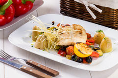 Fish with grilled vegetables Royalty Free Stock Photos