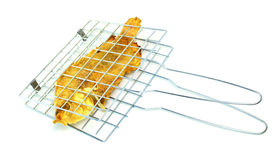 Fish on Grilling Basket on white background Stock Photography