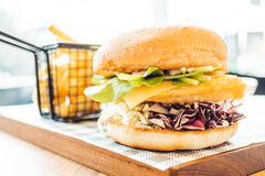 Fish hamburger with french fries Stock Photography
