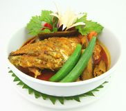 Fish Head Curry or also known as Kari Kepala Ikan. Indian Cuisine of Fish Head Curry is a popular food in Royalty Free Stock Photo
