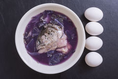 Fish head soup and eggs Stock Photos