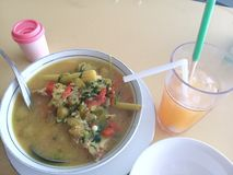 fish head soup, typical of south sulawesi stock photography