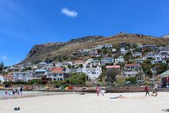 Fish Hoek Beach Sand. Close up of the sand and blue ocean at Fish Hoek Beach on a sunny day in Cape Town, South Africa Royalty Free Stock Photos
