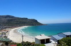 Fish Hoek from the Mountain. Birdseye view of beach with sand and blue ocean sea in Fish Hoek, Cape Town, South Africa Royalty Free Stock Photo