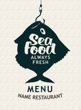 Fish on a hook. Banner for the store or seafood restaurant with fish on a hook Stock Photo