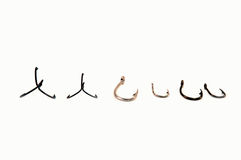 Fish Hooks. An assortment of fish hooks royalty free stock photo