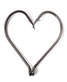 Fish hooks in heart shape. On white background Stock Photo