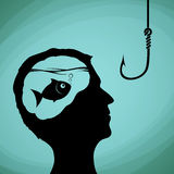 Fish in the human head. Man looking on a fishing hook. Lies, dec Stock Images