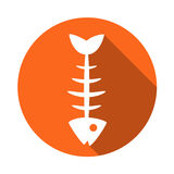 Fish icon . The icon of the fish bones. Fish skeleton icon. Fishing icon. Icon of fish bones. Skeleton of fish icon. Fishing icon round  orange icon for the fish Stock Image
