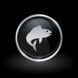 Fish icon inside round silver and black emblem. Aquatic marine animal symbol with fish icon inside round chrome silver and black button emblem on black Stock Image