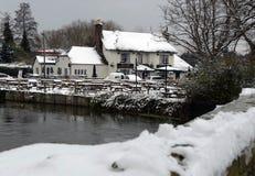 Fish Inn Ringwood. The Fish Inn Ringwood from the Bridge in The Snow stock image