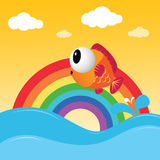 Fish jumping out of the water. With rainbow Stock Photography