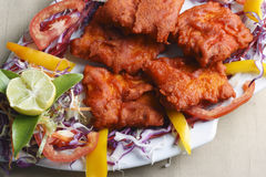 Fish Kebab - A snack made of grilled fish. Kebab refers to a variety of meat dishes in India and South Asian cuisines, consisting of grilled or broiled meats on Stock Photos