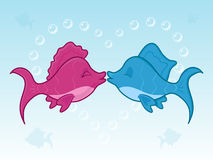 Fish kiss. Two fishes kissing underwater surrounded by the heart made of bubbles Royalty Free Stock Image