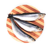 Fish on kitchen board Royalty Free Stock Photo