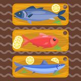 Fish on kitchen wooden chopping board fresh lemon top view seafood fishing cooking ingredients vector illustration. Natural sea nutrition dinner cook gourmet Stock Photo