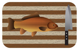 Fish and  knife on a chopping board. Top view. Stock Photos