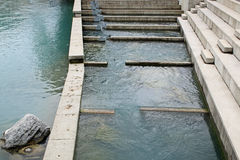 Fish ladder also known as fishway, fish pass or fish steps. It is a structure that allows migrating fish passage over or around an obstacle on a river in royalty free stock photography