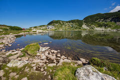 The Fish lake and mountain hut, The Seven Rila Lakes, Rila Mountain Stock Photo