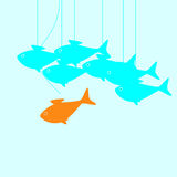 Fish leader. Business concept illustration with goldfish moving its own way breaking common rules in the form of puppet thread that holds it and does not allow Royalty Free Stock Image