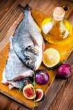 Fish with lemon and figs, Mediterranean Stock Image
