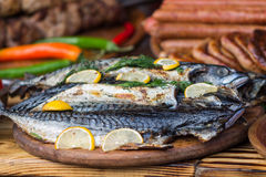 Fish with lemon food photo. Cooked fried fish with lemon food photo on plate in restaurant stock image