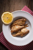 Fish with lemon lobule on plate Stock Image