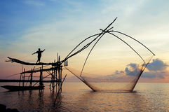 Fish lift net in Phatthalung. Water scape scene with square dip net in Patthalung,Thailand /Traditional fishing Royalty Free Stock Images