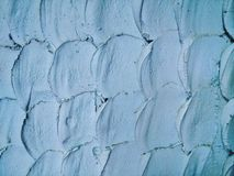 Fish-like scale pattern on cement wall Royalty Free Stock Photo