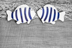 Fish lovers greeting card. Fish lovers decoration as maritime greeting card on wooden background Stock Images