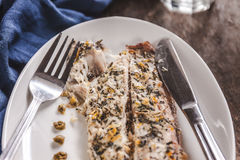 Fish mackerel baked with herbs, mashed potatoes, pesto sauce ser Stock Photography