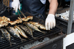 Fish mackerel and chicken tabaka grilled at bbq Royalty Free Stock Photo
