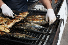 Fish mackerel and chicken tabaka grilled at bbq Stock Photos