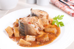 Fish mackerel with tomato and potato stew Royalty Free Stock Photo