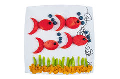 Fish made from fruits. Fun food. Fish made from fruits royalty free stock image