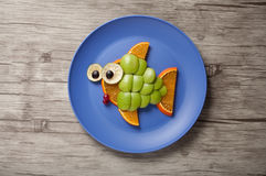Fish made of green apple Stock Image