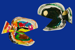 Fish made from paper plates and painted by child. Fish crafted by a child  against a blue background Stock Images