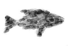 Fish Made Up of Black Ink Fingerprints. Abstract Royalty Free Stock Images
