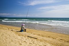 Fish man on the beach Royalty Free Stock Photo