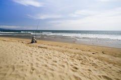 Fish man on the beach Stock Image
