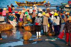 Fish market in Long Hai - Vietnam. Long Hai, Ba Ria - Vung Tau Province, Vietnam. A group of local people doing daily's work at Phuoc Hai Fish Market, Long Hai Stock Photo