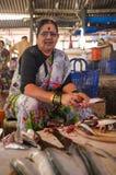 Fish market in Mumbai. MUMBAI, INDIA - 11 JANUARY 2015: Woman cleaning fish in Anderi fish market Royalty Free Stock Image